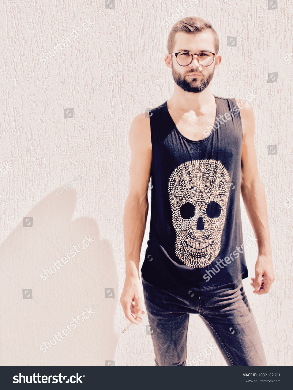 Young Handsome Hipster Man Smoking Cigarette Stock Photo