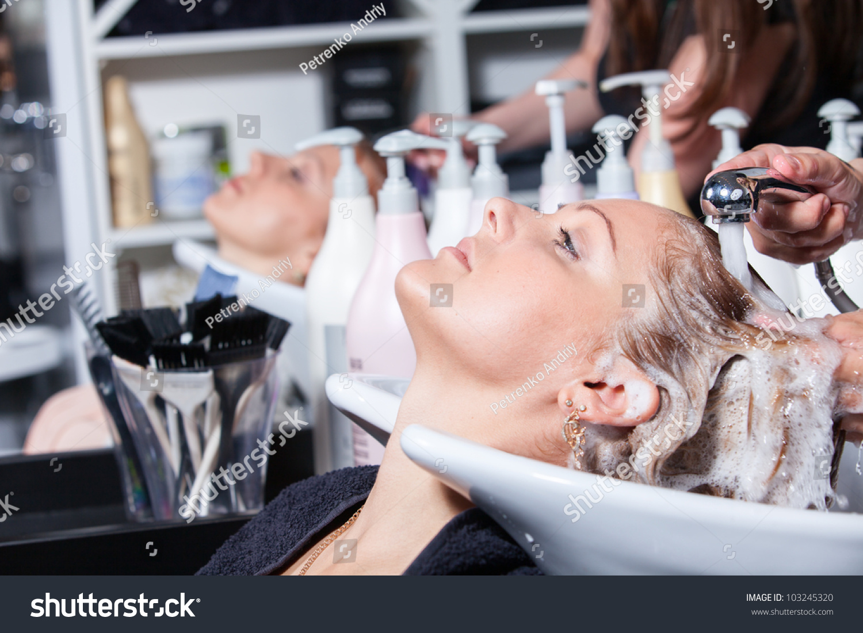 Hair washing hairdressing salon young caucasian stock for Wash hair salon