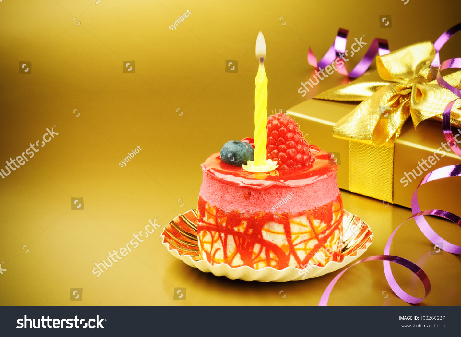 Colorful Birthday Cake Candle On Golden Stock Photo