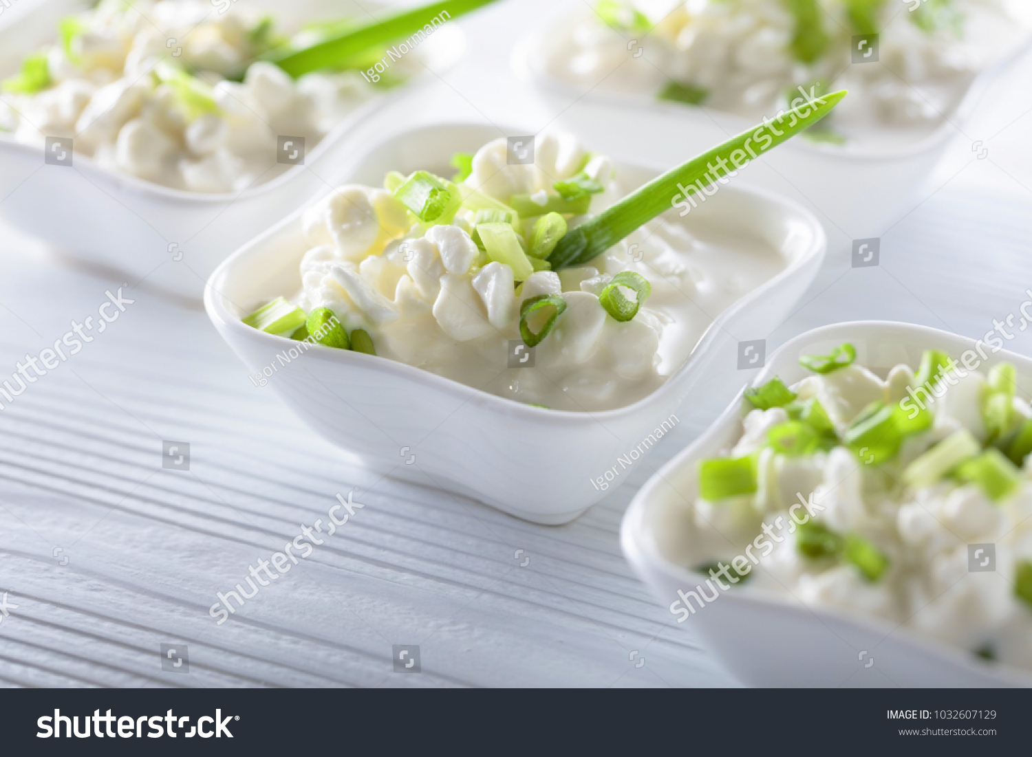 Homemade Cottage Cheese With Green Onions On White Wooden Table.