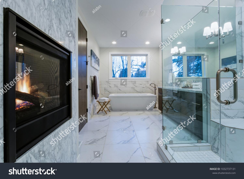 Incredible Master Bathroom Fireplace Carrara Marble Stock Photo ...