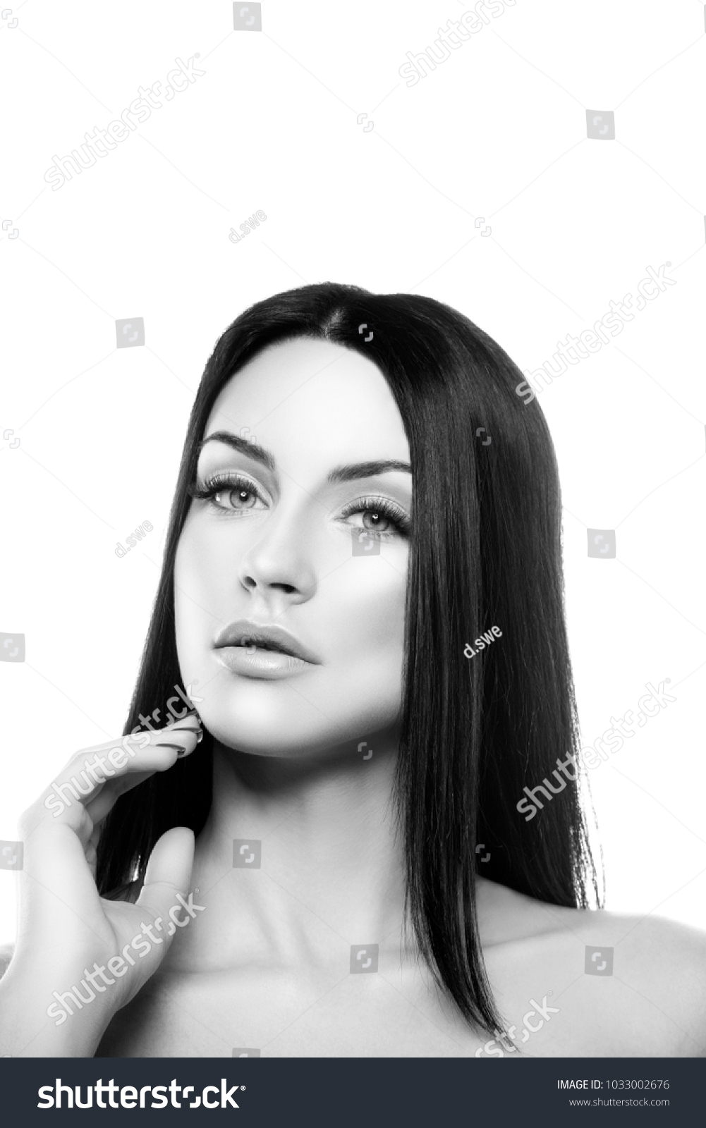 Beautiful portraitof young girl with natural lips, nude makeup and clean  skin over white background