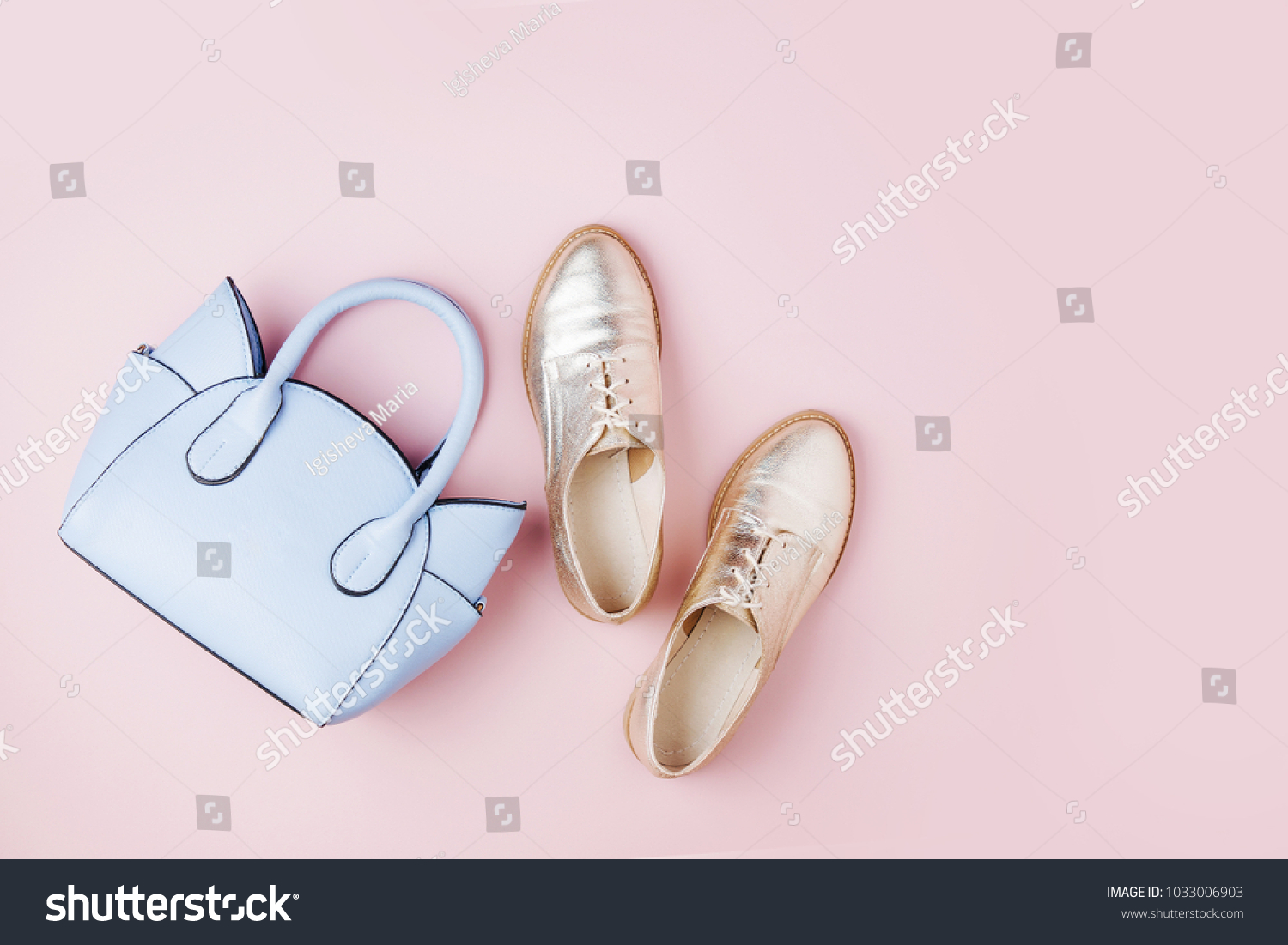 Cute blue ladies bag and stylish golden shoes. Flat lay, top view. Spring fashion concept in pastel colored #1033006903