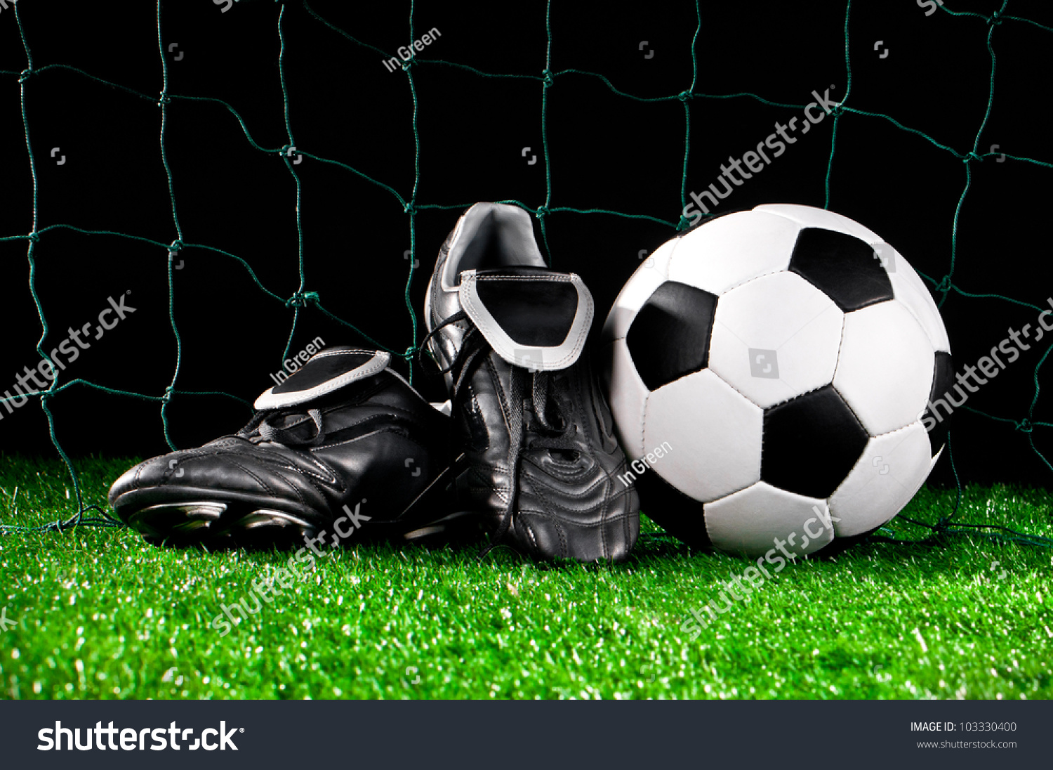 soccer ball cleats on football field stock photo 103330400