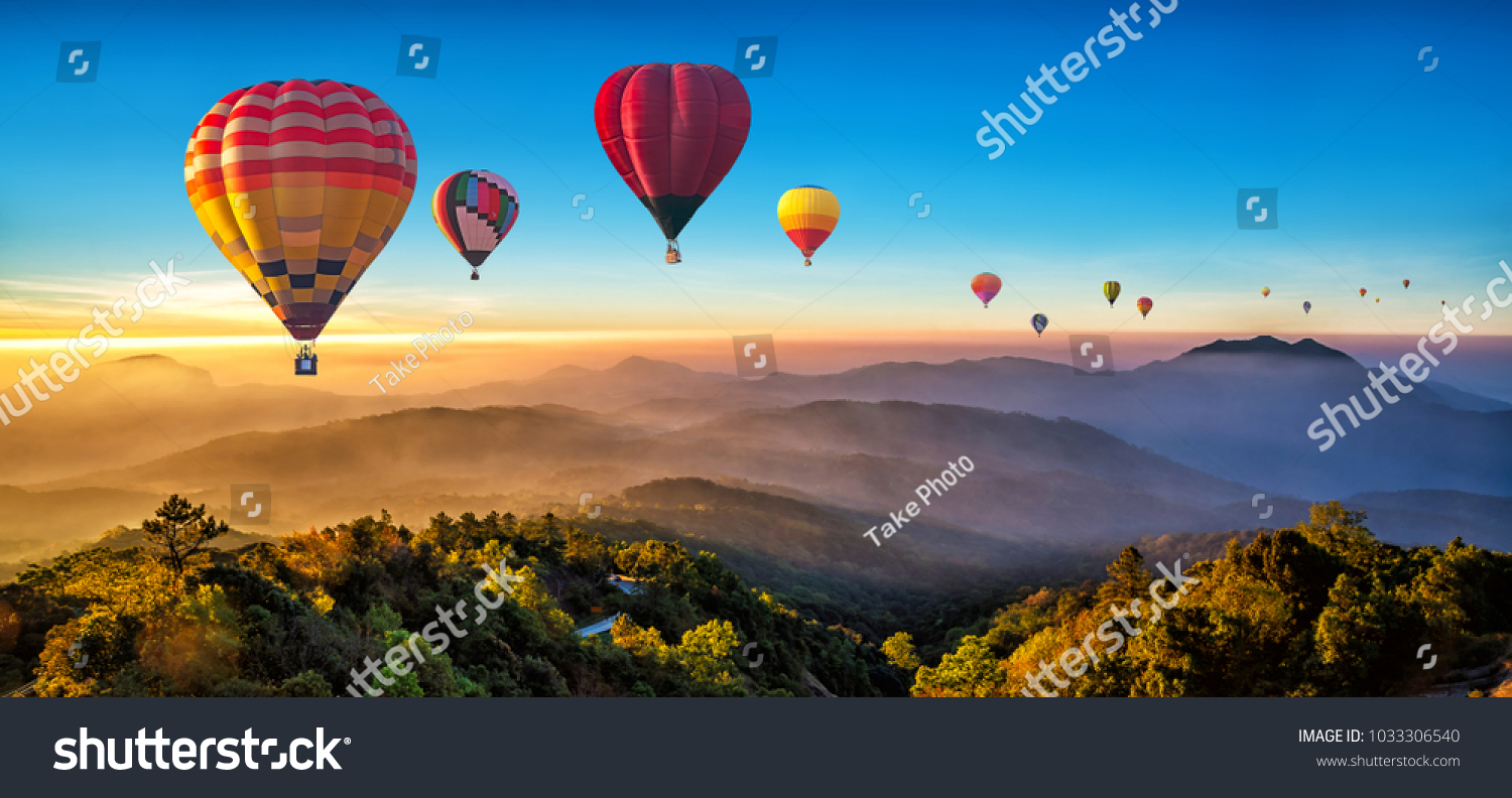 Colorful hot air balloons flying over mountain at Dot Inthanon in Chiang Mai, Thailand. #1033306540