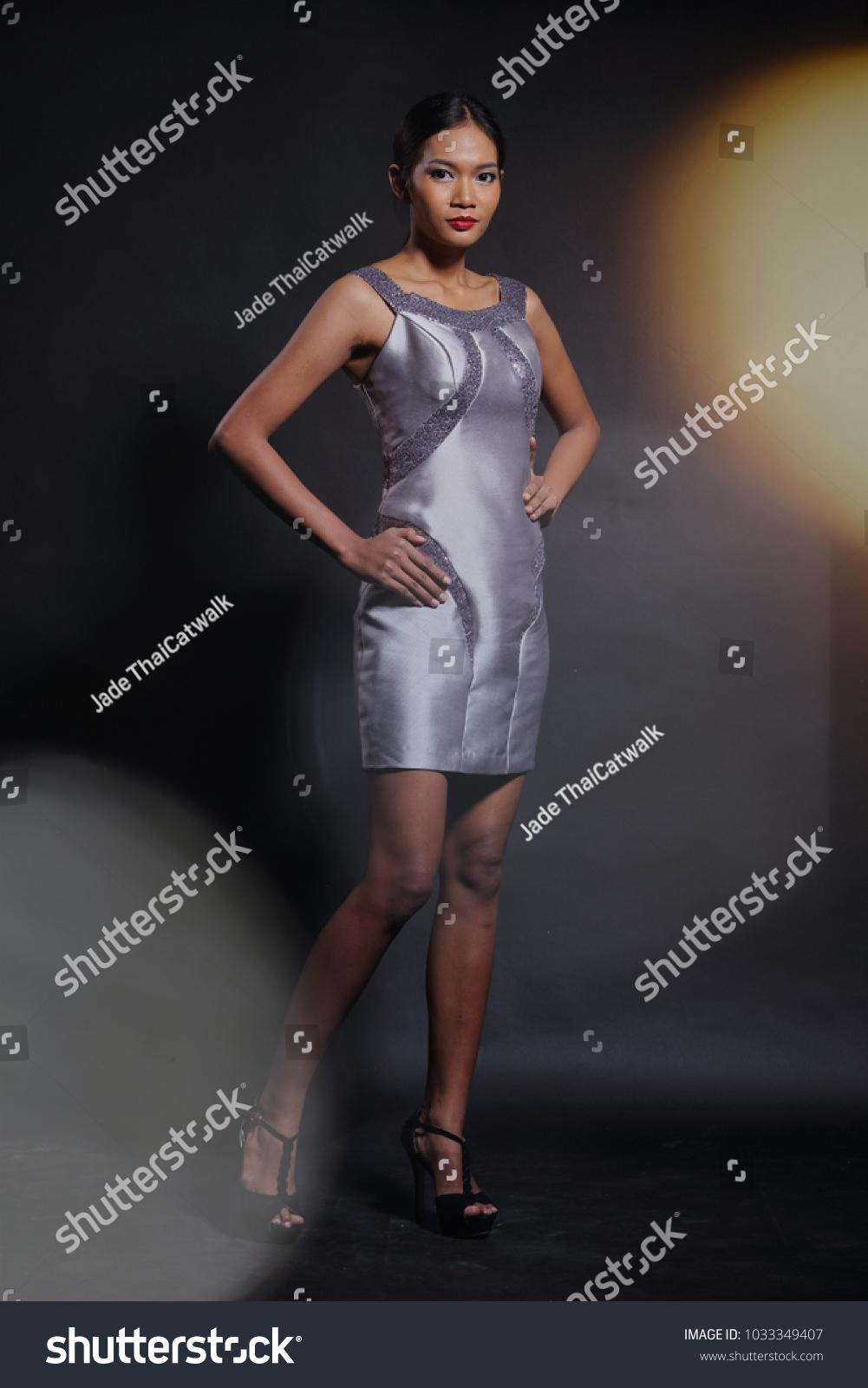 Asian Tan Skin Woman Model in slim Silver Silk short evening Gown ...