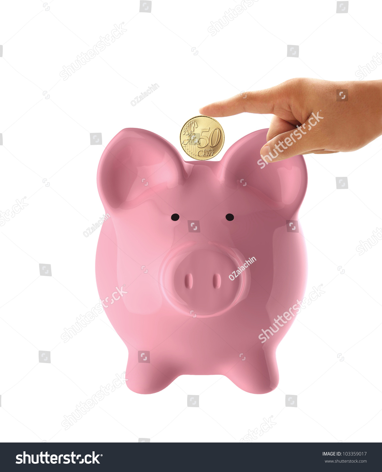 hand putting coin into pink piggy stock photo 103359017