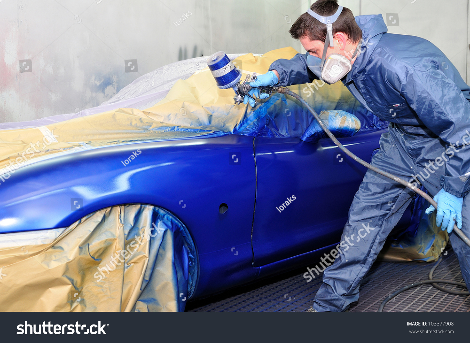 worker painting a car in a paint booth stock photo 103377908. Black Bedroom Furniture Sets. Home Design Ideas