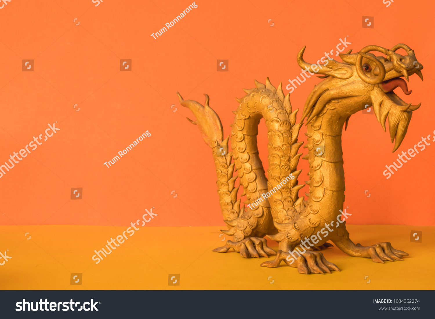Golden dragon statue symbol wealth power stock photo 1034352274 golden dragon statue is a symbol of wealth and power in the faith of chinese on biocorpaavc Images