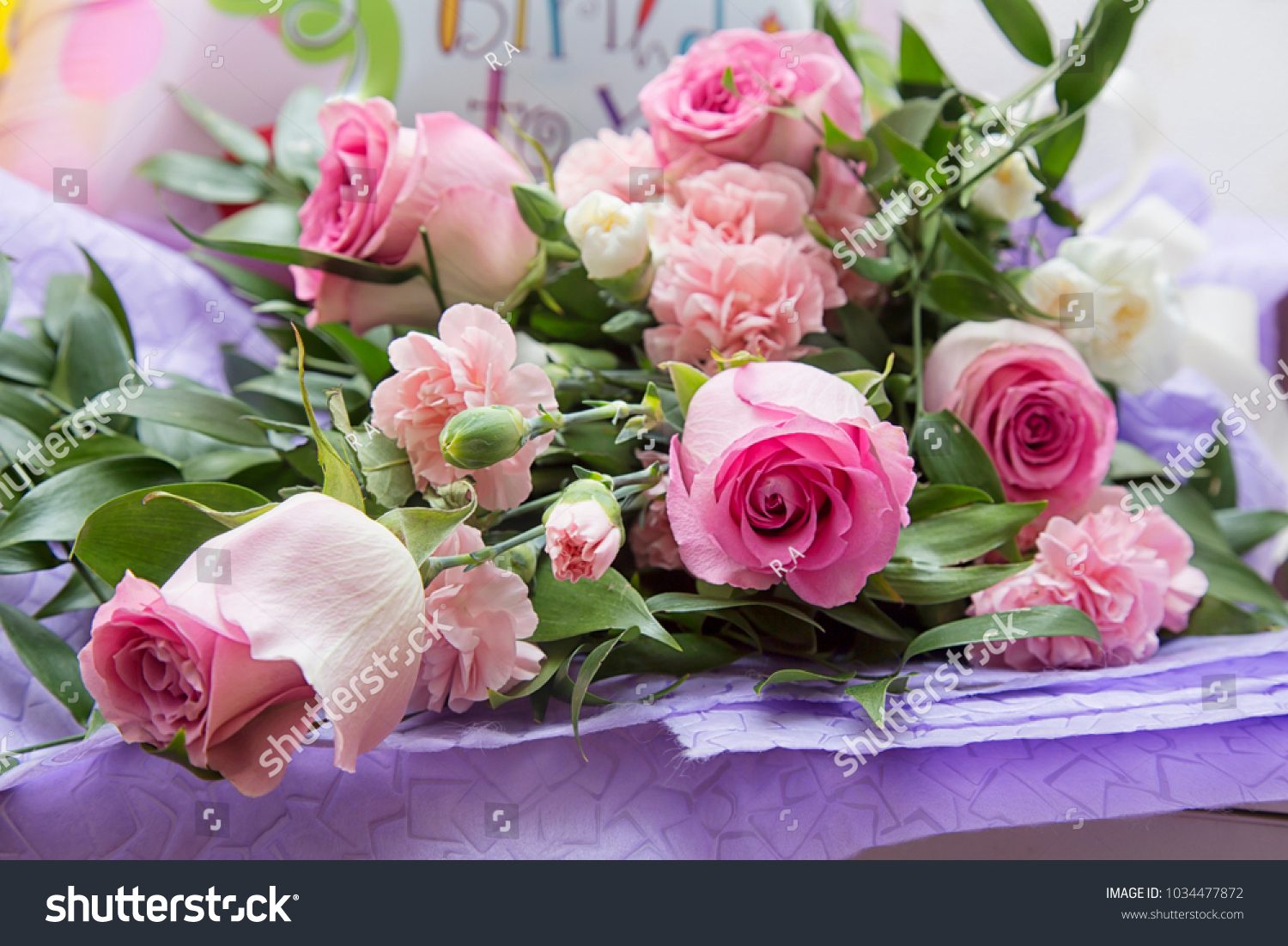 A bouquet of flowers from roses and balloons is a gift for a happy id 1034477872 izmirmasajfo