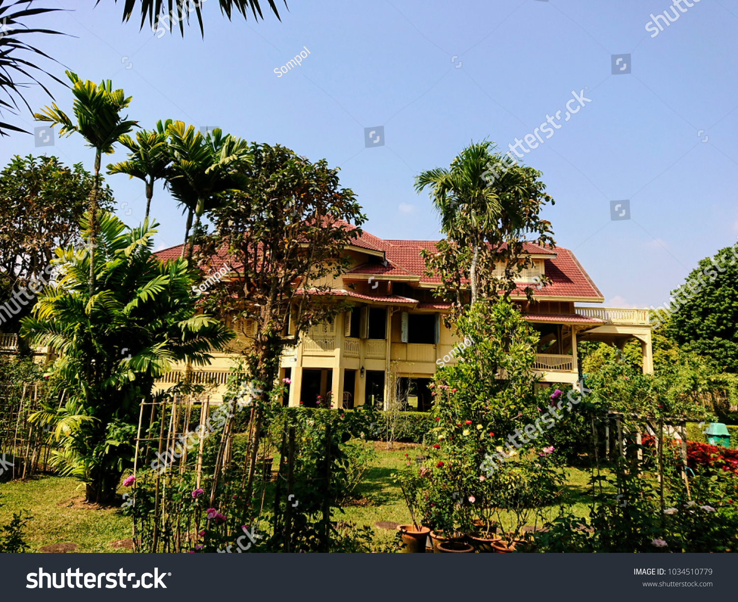 A garden with trees on a green lawn with the beautiful Dara Pirom ...