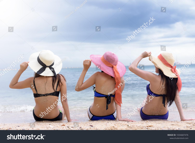 efb097c132df8 Three cute girls friend relax on the beach. Vacation at paradise. Ocean  beach relax