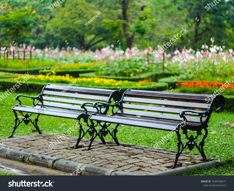 Park Bench Has Flower Garden Back Stock Photo Edit Now 1034702671