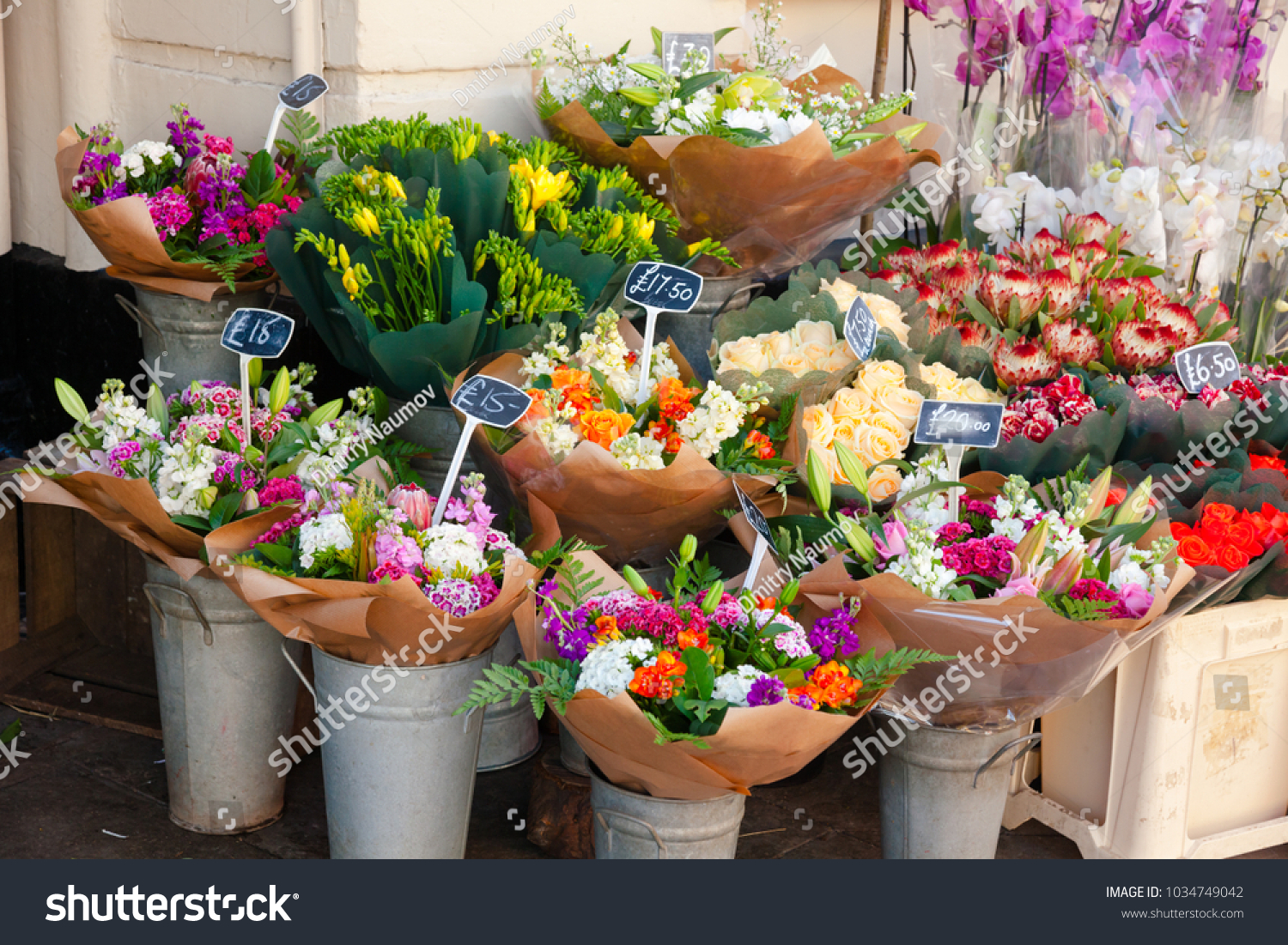 Various flower bouquets baskets price tags stock photo edit now various flower bouquets in baskets with price tags for sale at a street market in england izmirmasajfo