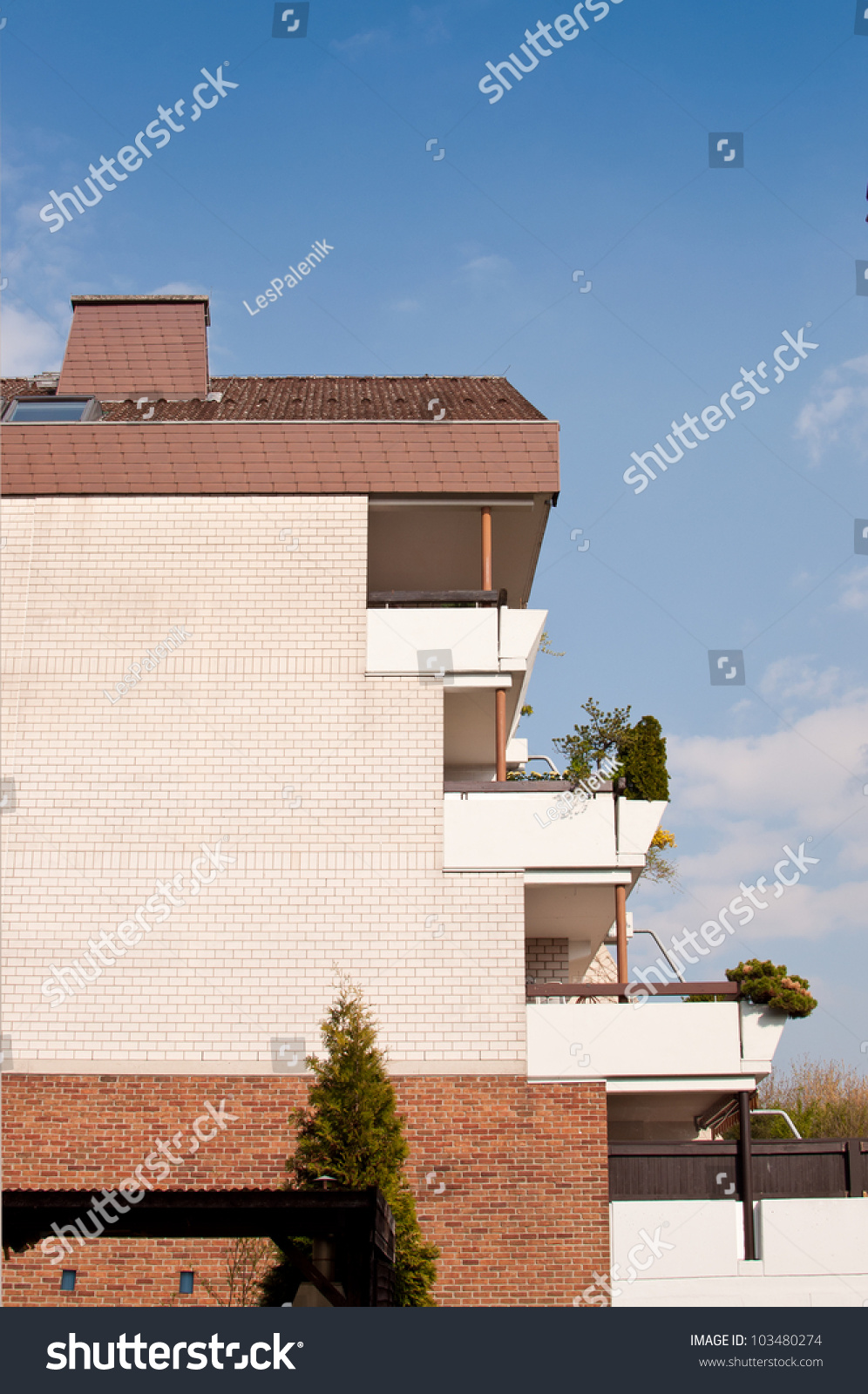 Apartment building with terrace balconies stock photo for Building balcony