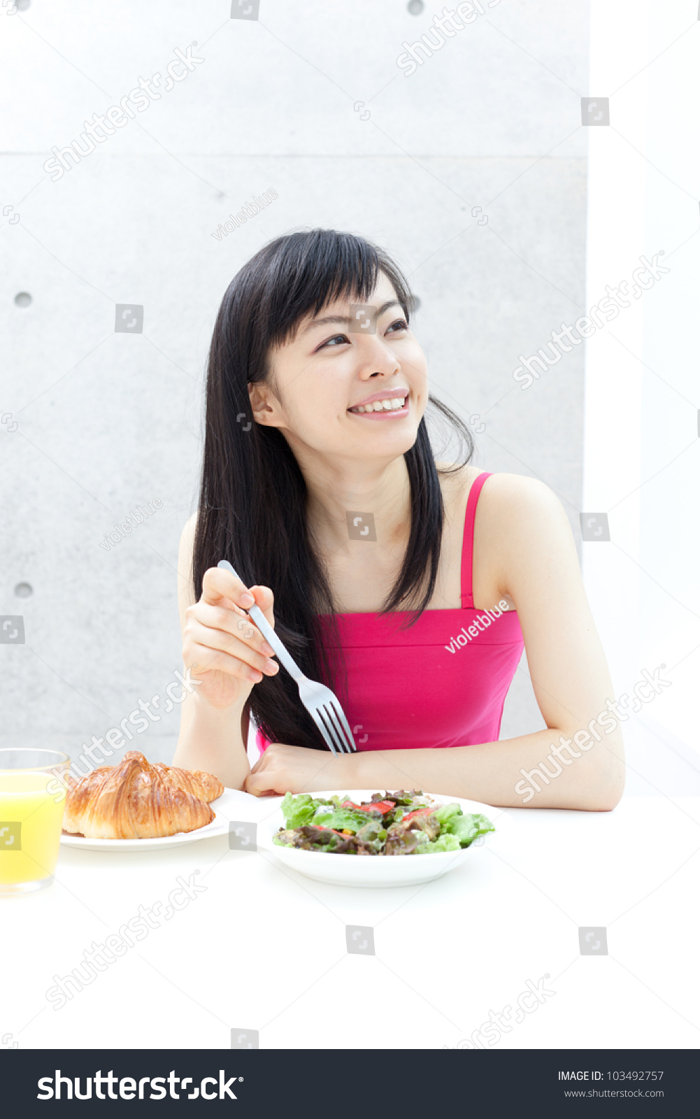 Beautiful Eat In Kitchens: Beautiful Young Girl Eating Breakfast Stock Photo