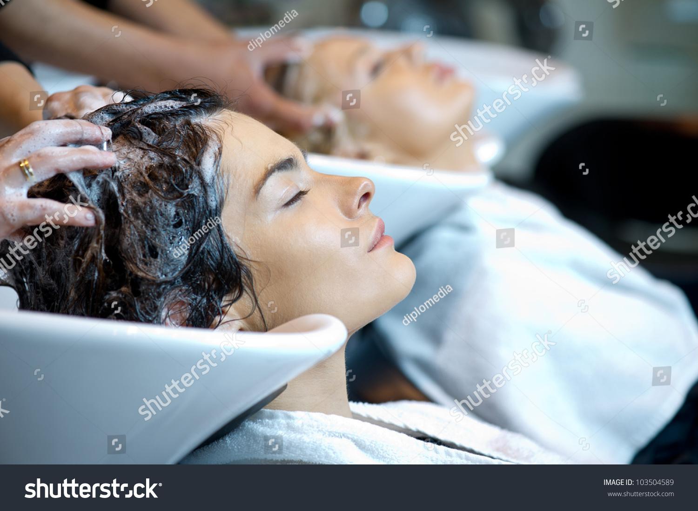 Beautiful woman getting a hair wash in a hair salon stock for Wash hair salon