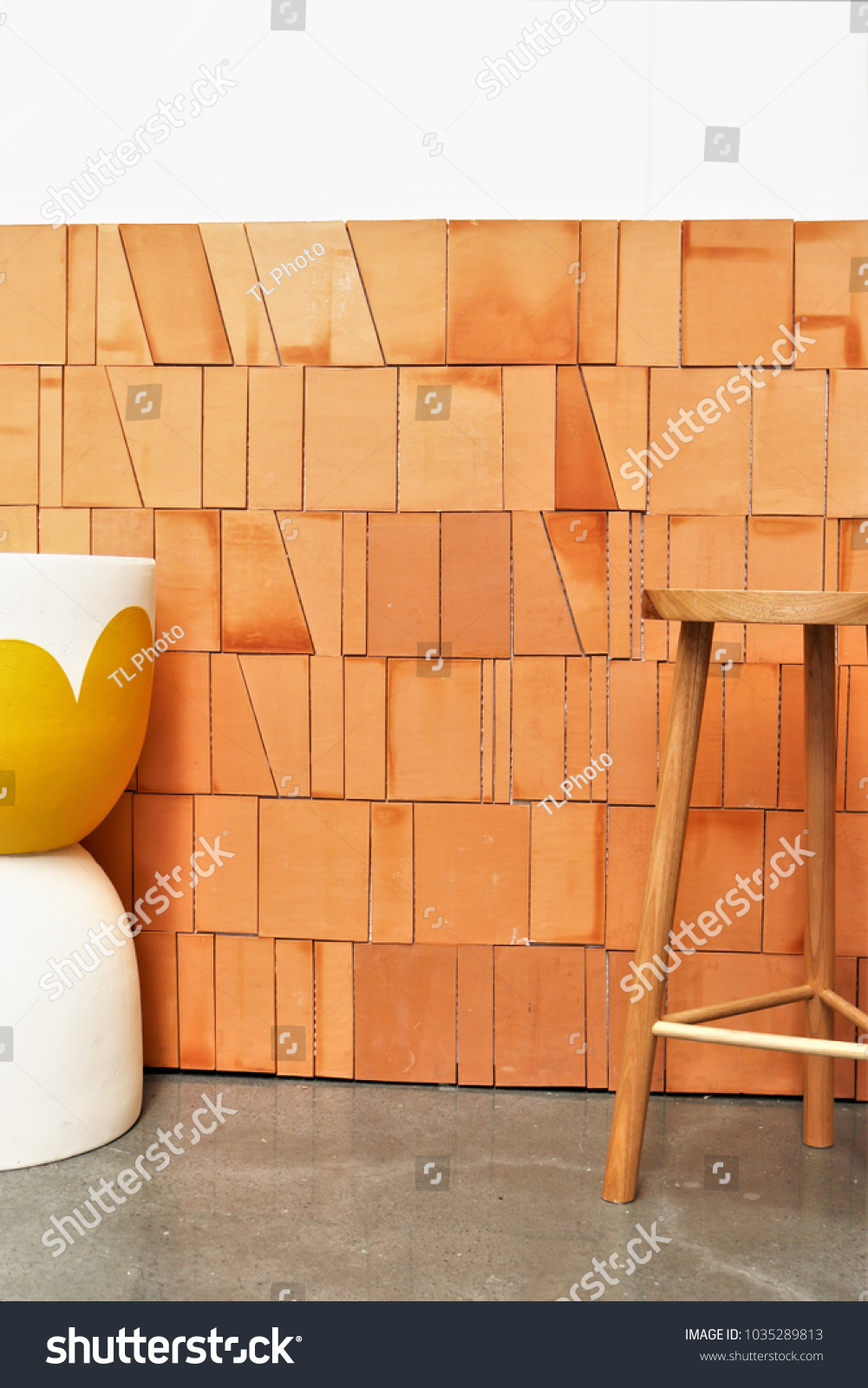 Terracotta tile wall background timber stool stock photo 1035289813 terracotta tile wall background with timber stool and ceramic pot dailygadgetfo Image collections