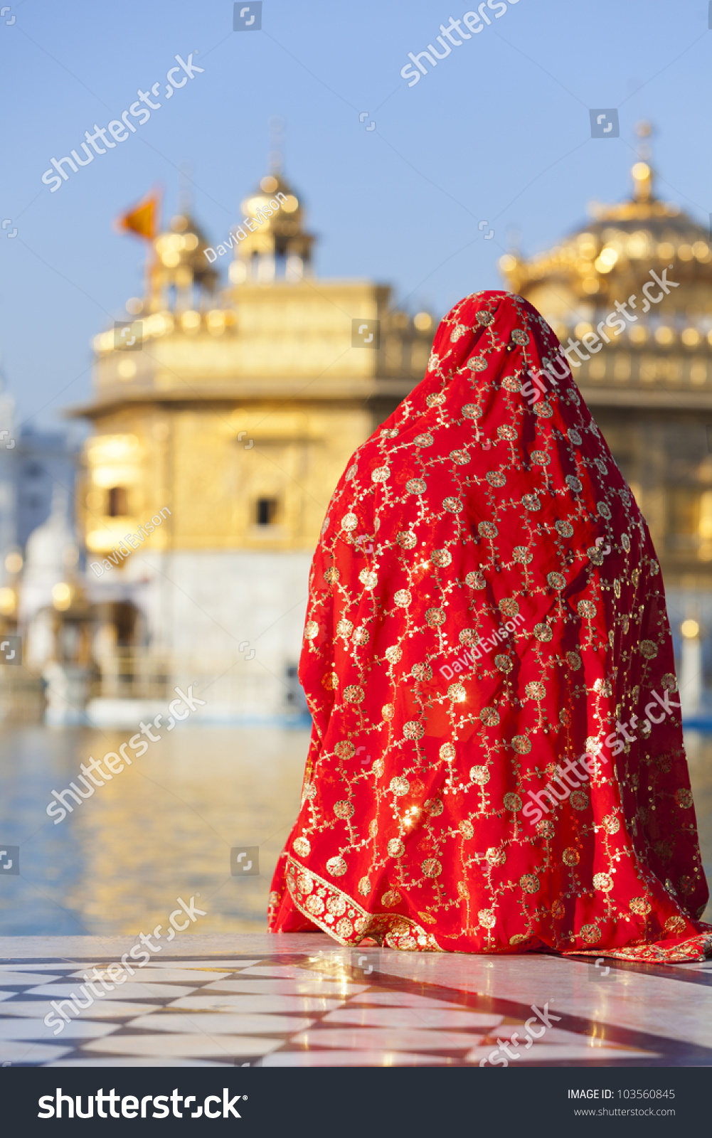 a woman in a red saree sat opposite the golden temple in amritsar india stock photo 103560845. Black Bedroom Furniture Sets. Home Design Ideas