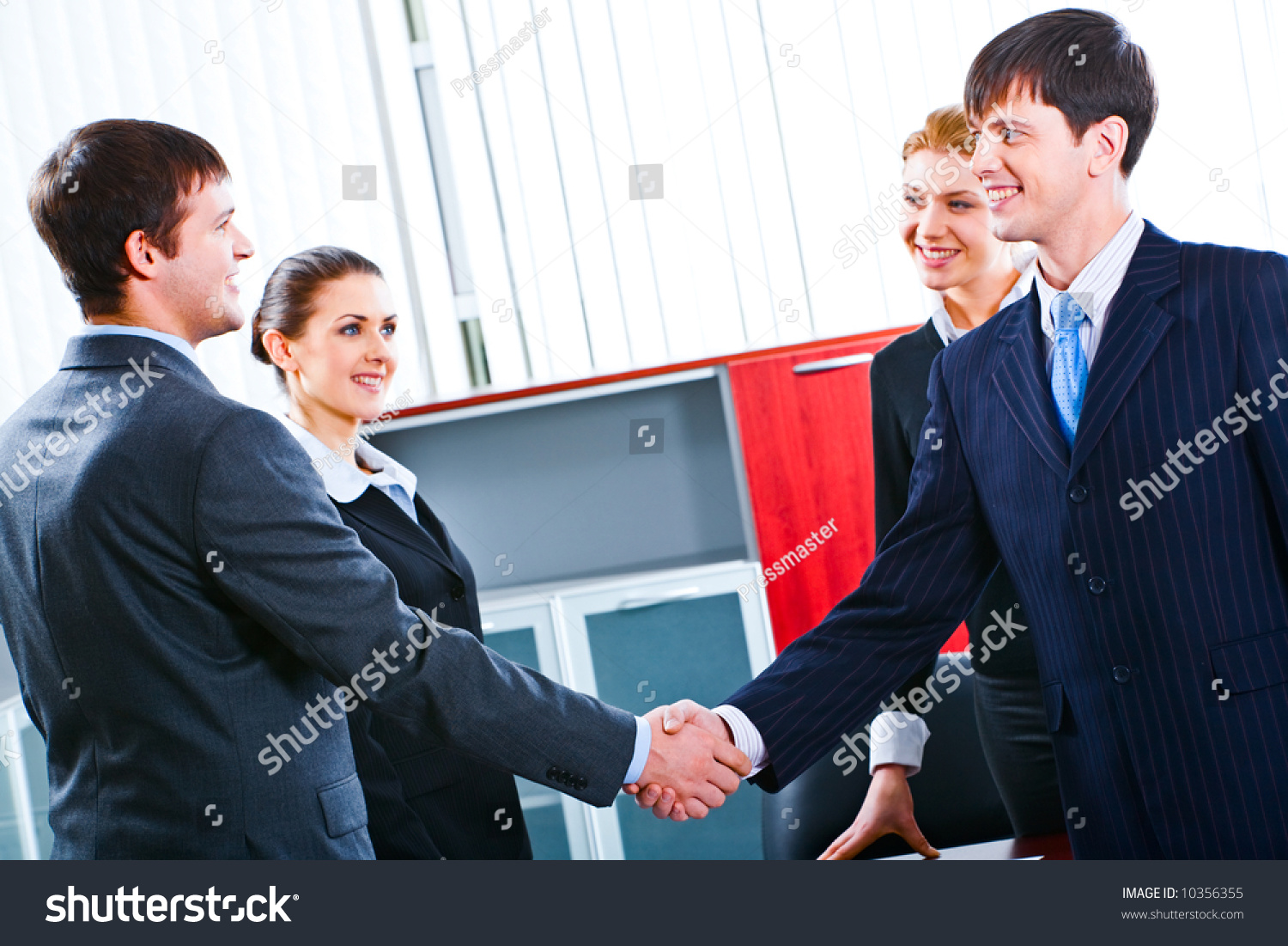 Business people handshake greeting deal at work photo free download - Successful Handshake Of Confident Business People Making A Deal