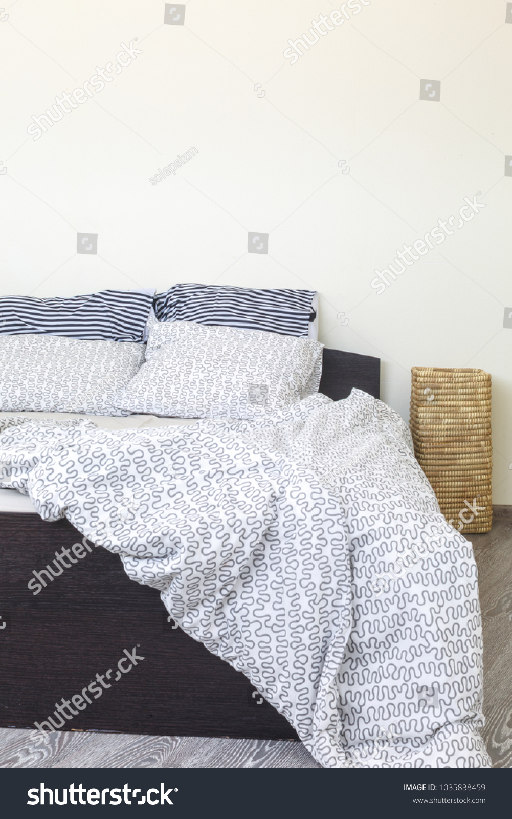 natural light morning bedroom interior, bedclothes unclean, bright and cozy, minimalistic design #1035838459