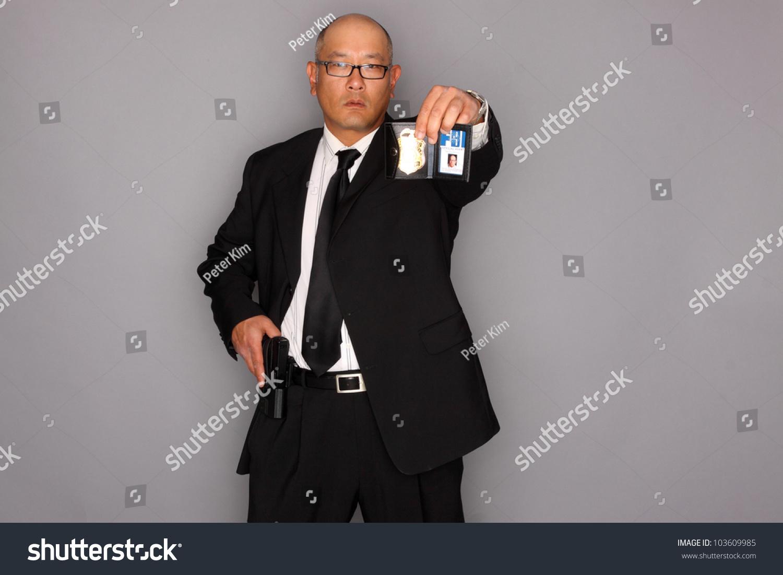 man with gun badge - photo #1
