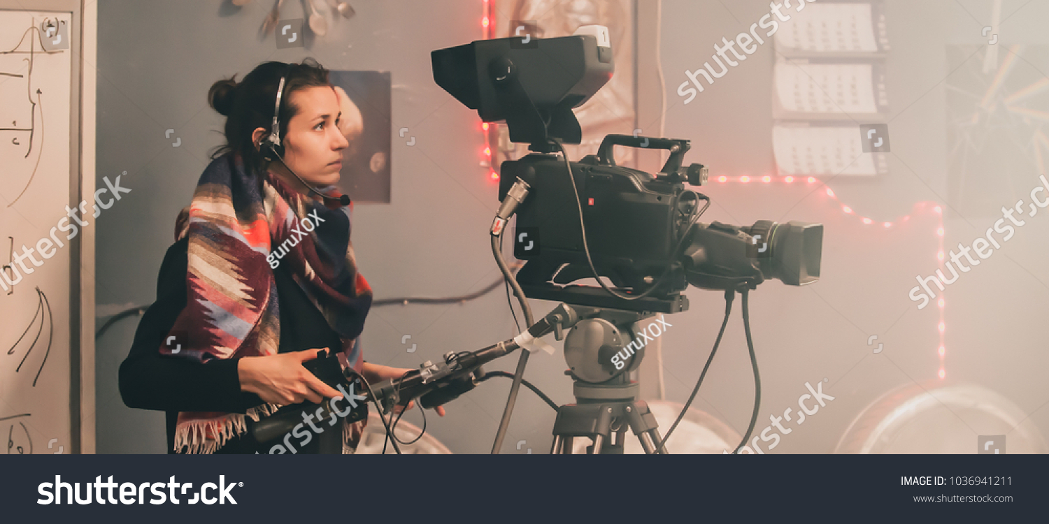 Behind the scene. Female cameraman shooting the film scene with camera in film studio #1036941211 - 123PhotoFree.com