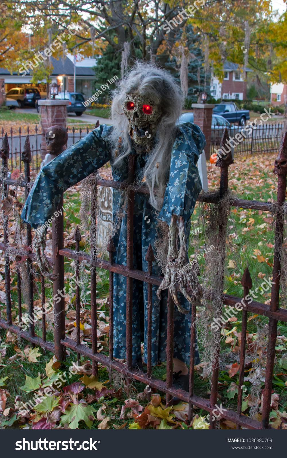 spooky female skeleton haunted house dusk stock photo (edit now