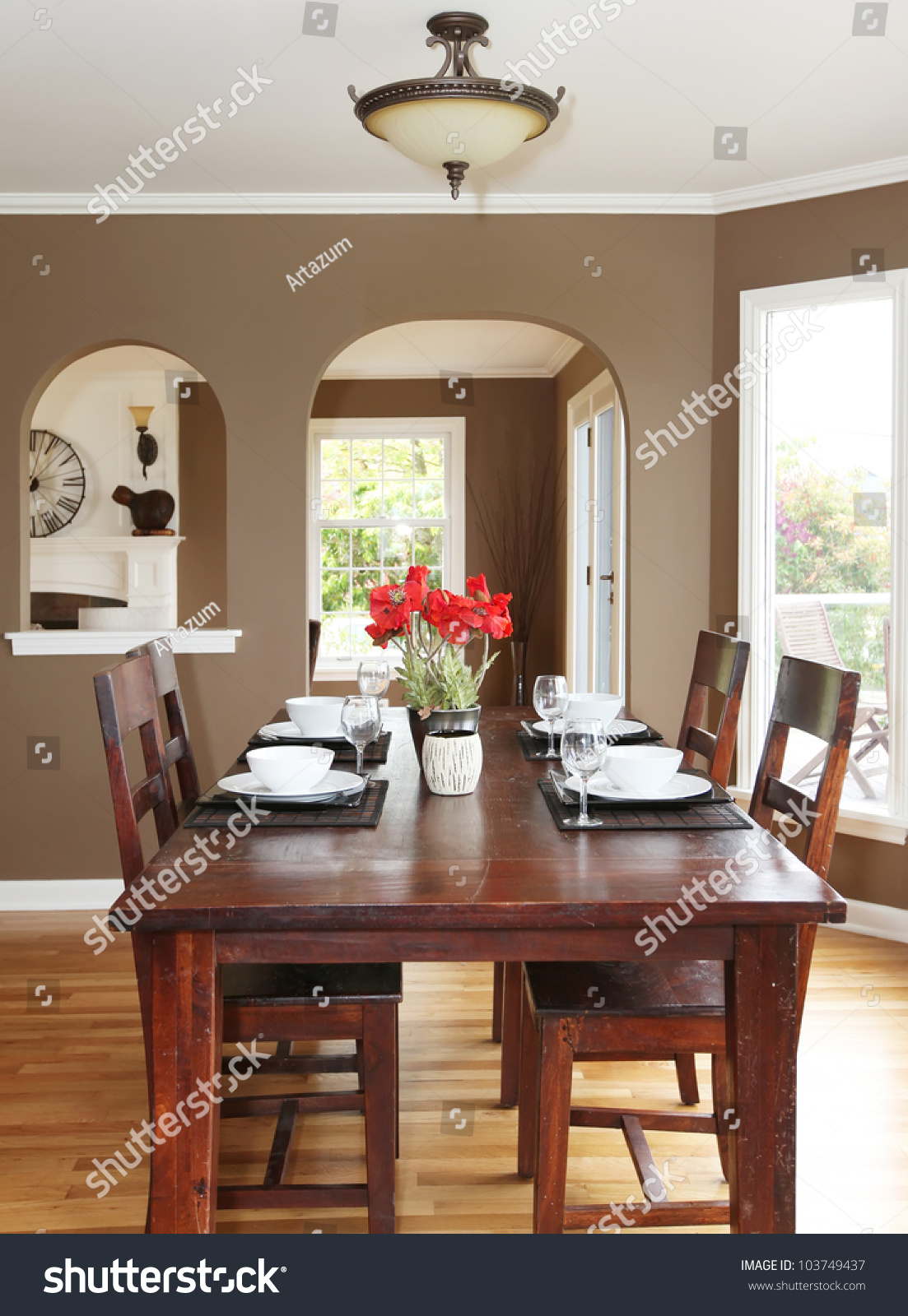 Dining Room With Brown Walls And Wood Table In The Luxury