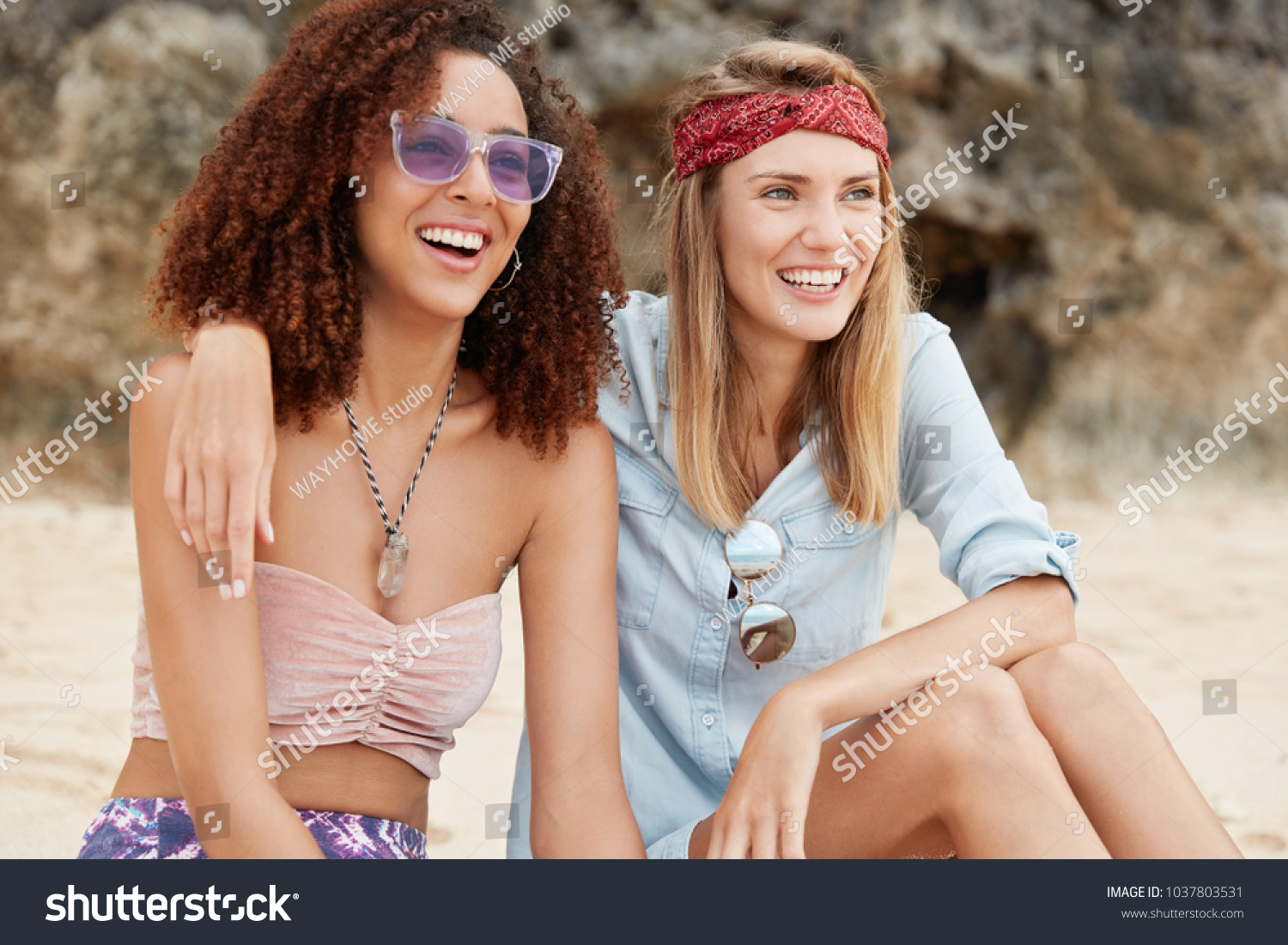 Homosexual relationships and love concept. Female lesbians have positive  looks, hug each other,