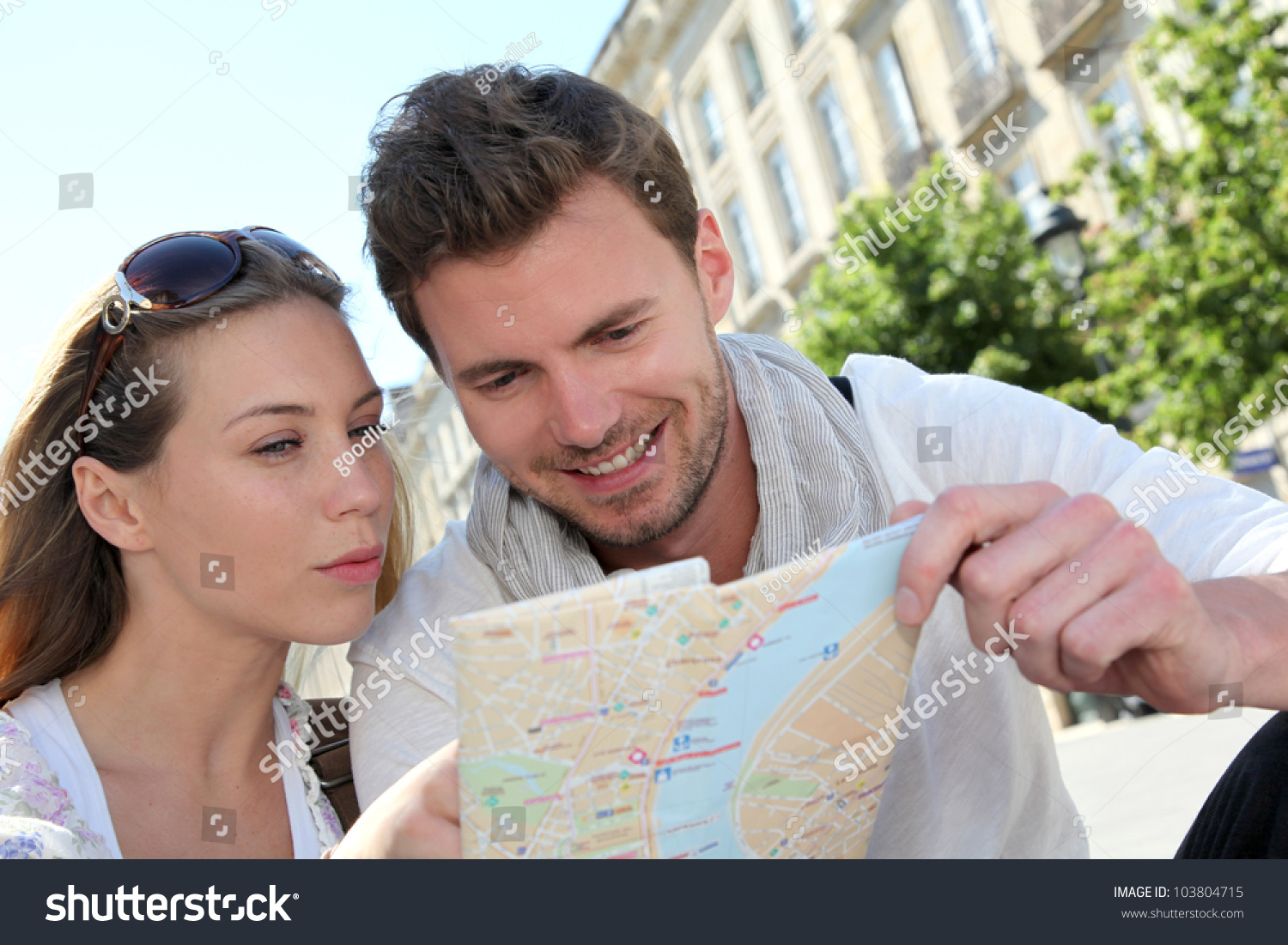 Couple Of Tourists Looking At City Tour Map Stock Photo ...
