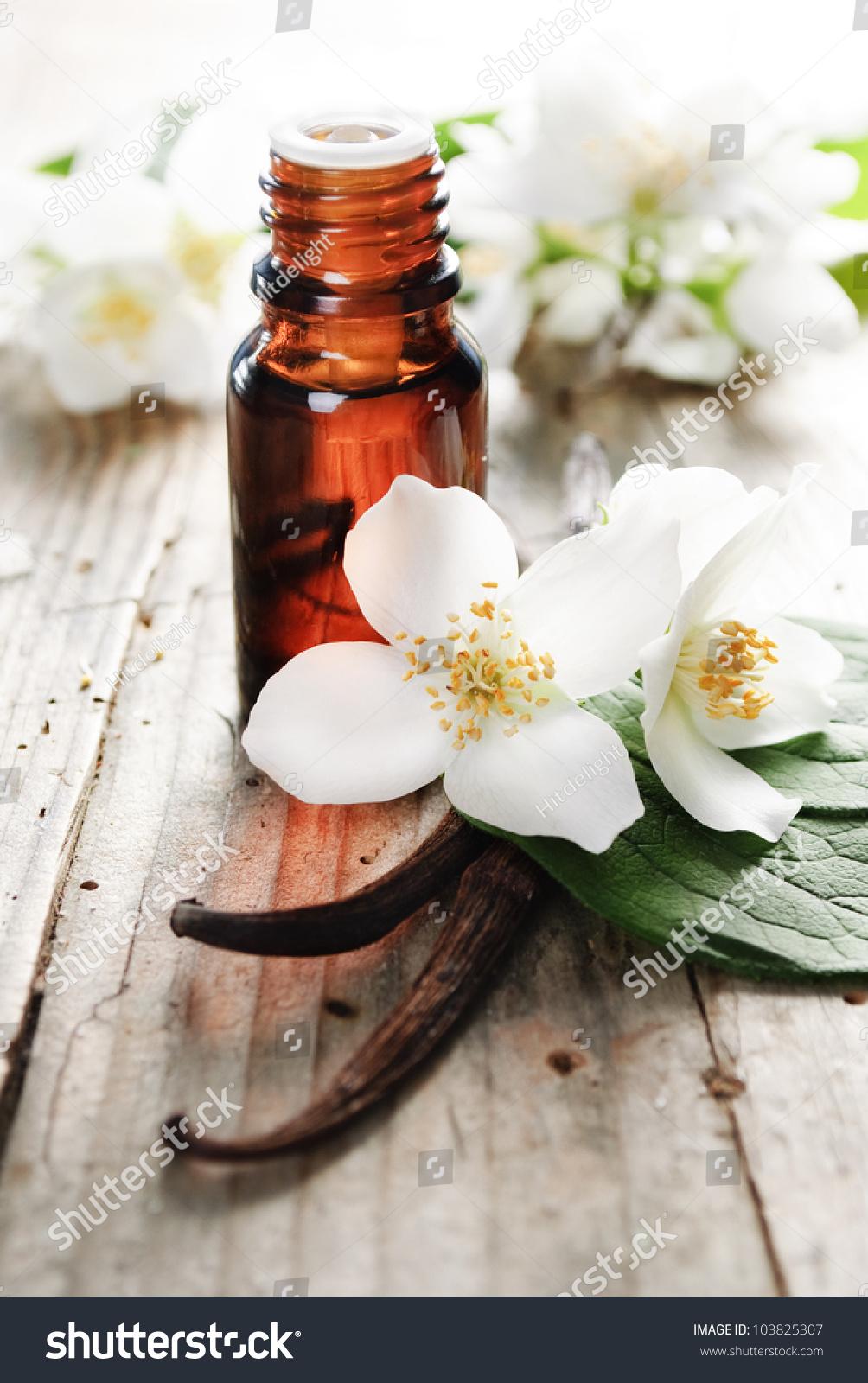 Essential Oil With Jasmine Flower On A Wooden Background Ez Canvas