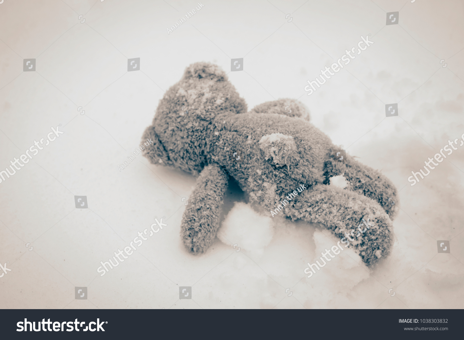 Rear view teddy bear lying alone stock photo safe to use rear view teddy bear lying alone on snow during winter time in vintage filter selective thecheapjerseys Gallery