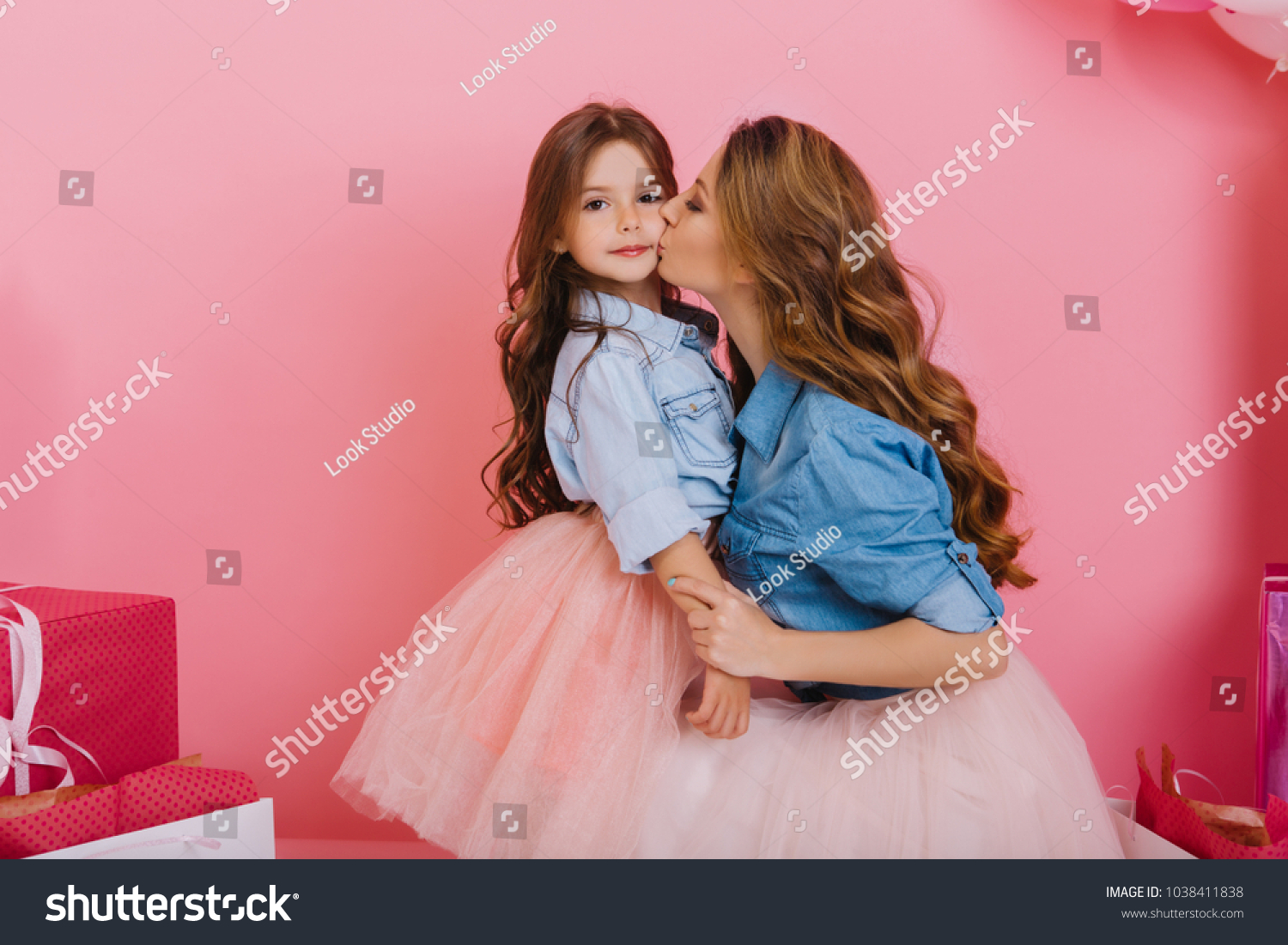 Charming Little Brunette Girl Spending Time With Her Young Beautiful Mom At Birthday Party Adorable