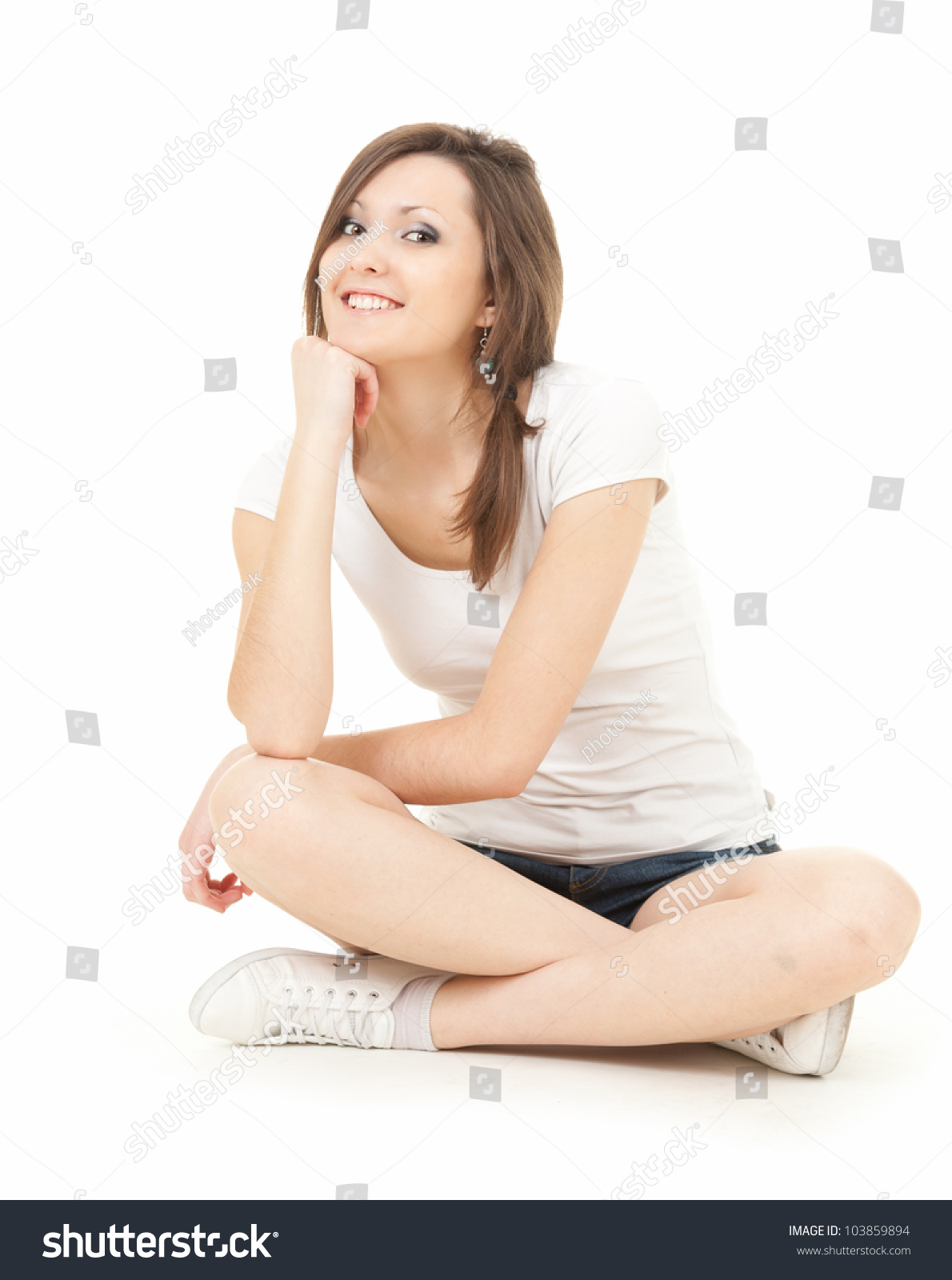 happy teenage girl sitting on the floor with crossed legs full length white background stock. Black Bedroom Furniture Sets. Home Design Ideas