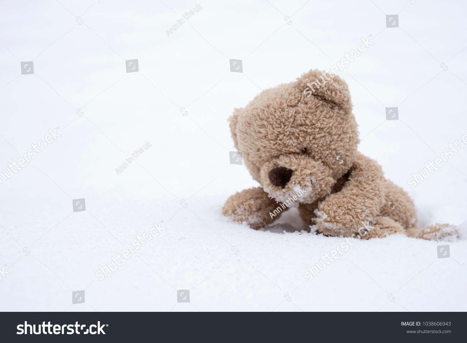 One teddy bear sitting alone on stock photo 100 legal protection one teddy bear sitting alone on snow during winter time a cute brown bear climbing altavistaventures Choice Image