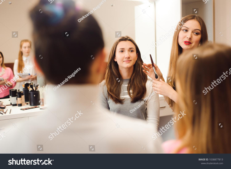 Makeup teacher her student girls makeup stock photo 1038877813 makeup teacher with her student girls makeup tutorial lesson at beauty school makeup master baditri Images