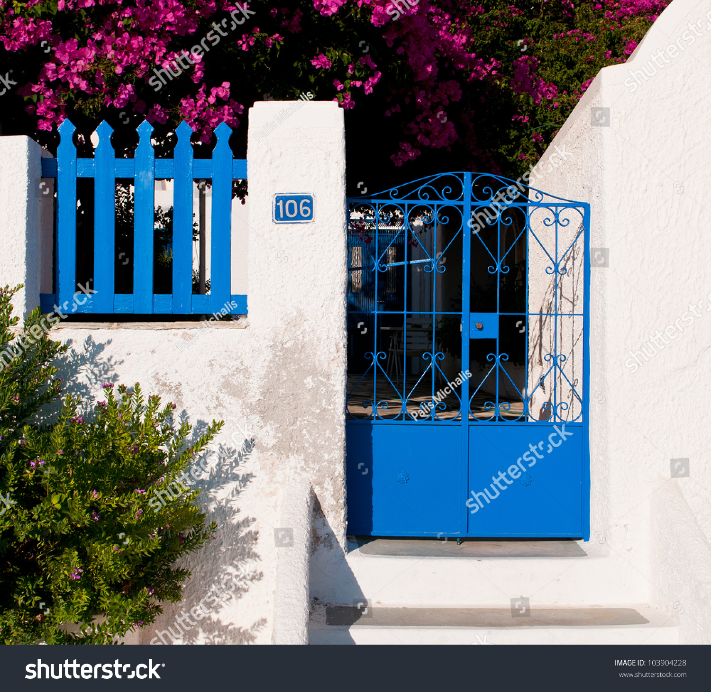 Traditional Greek House blue entrance metal door traditional greek stock photo 103904228