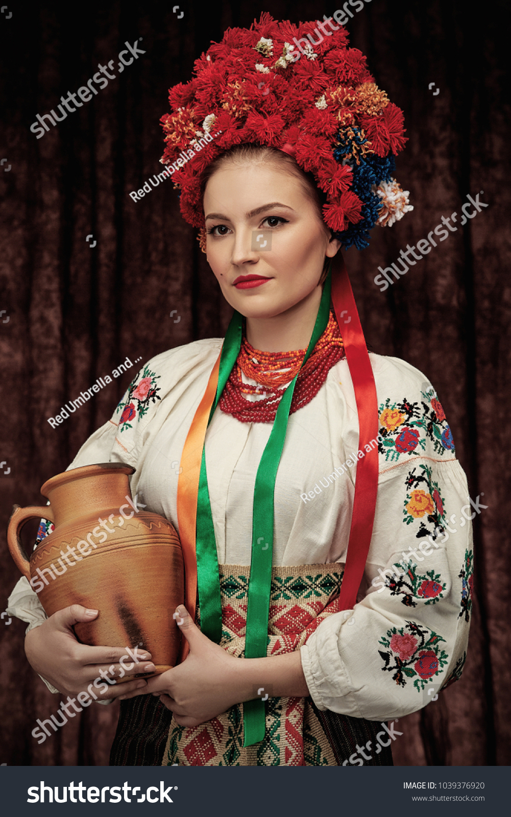 Portrait attractive woman standing traditional slavic stock photo portrait of attractive woman standing in traditional slavic costume wearing embroidered blouse flower crown izmirmasajfo