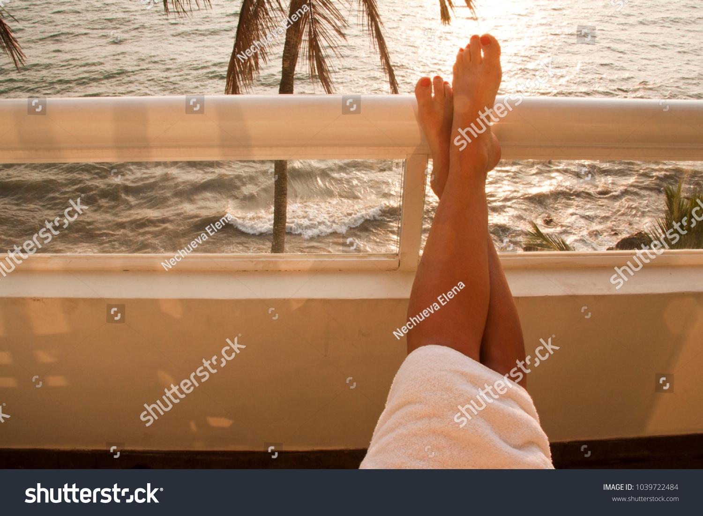 9f6eeca53b83bc Stock photo very nice relax photo legs on balcony with sea view jpg  1500x1101 Nice tan