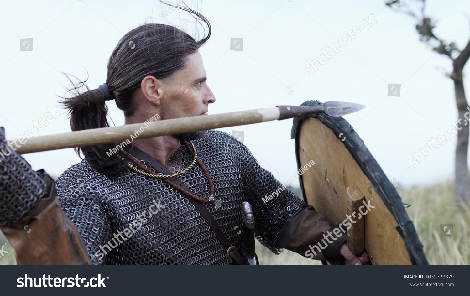 Viking Warrior Throws Spear During Attack Stock Photo (Edit