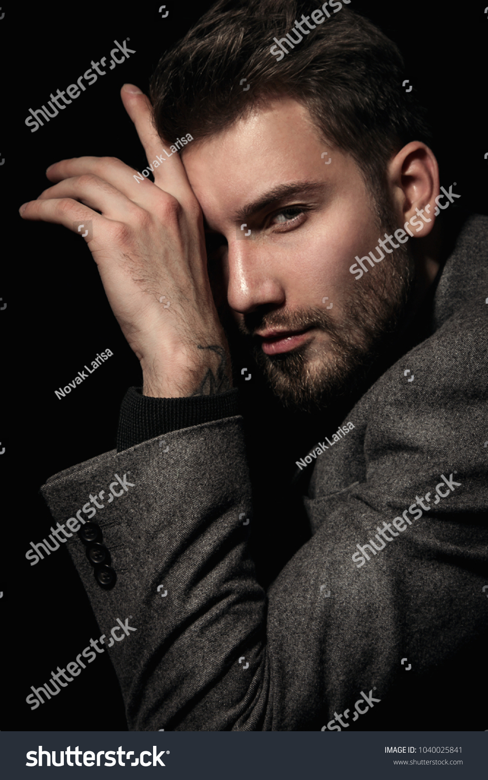 Handsome brutal man in gray suit cool hair style.Sexy Businessman. Confident, attractive, stylish. Fashion shooting. Actor. #1040025841