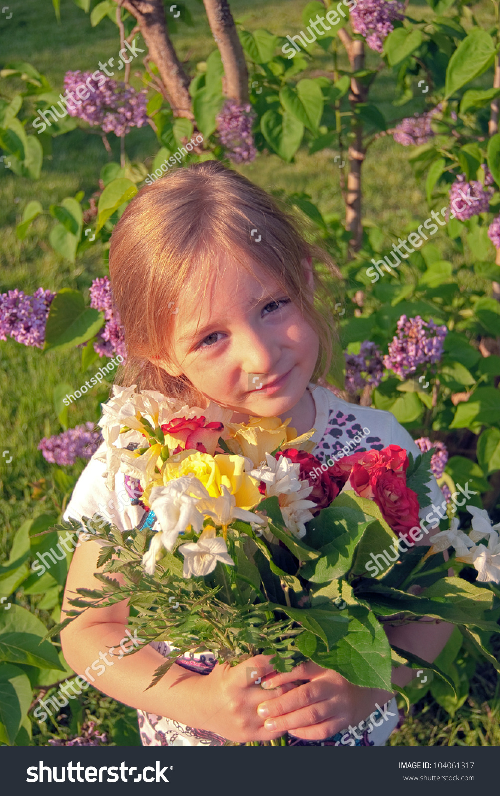 cute little girl flowers garden stock photo (royalty free) 104061317
