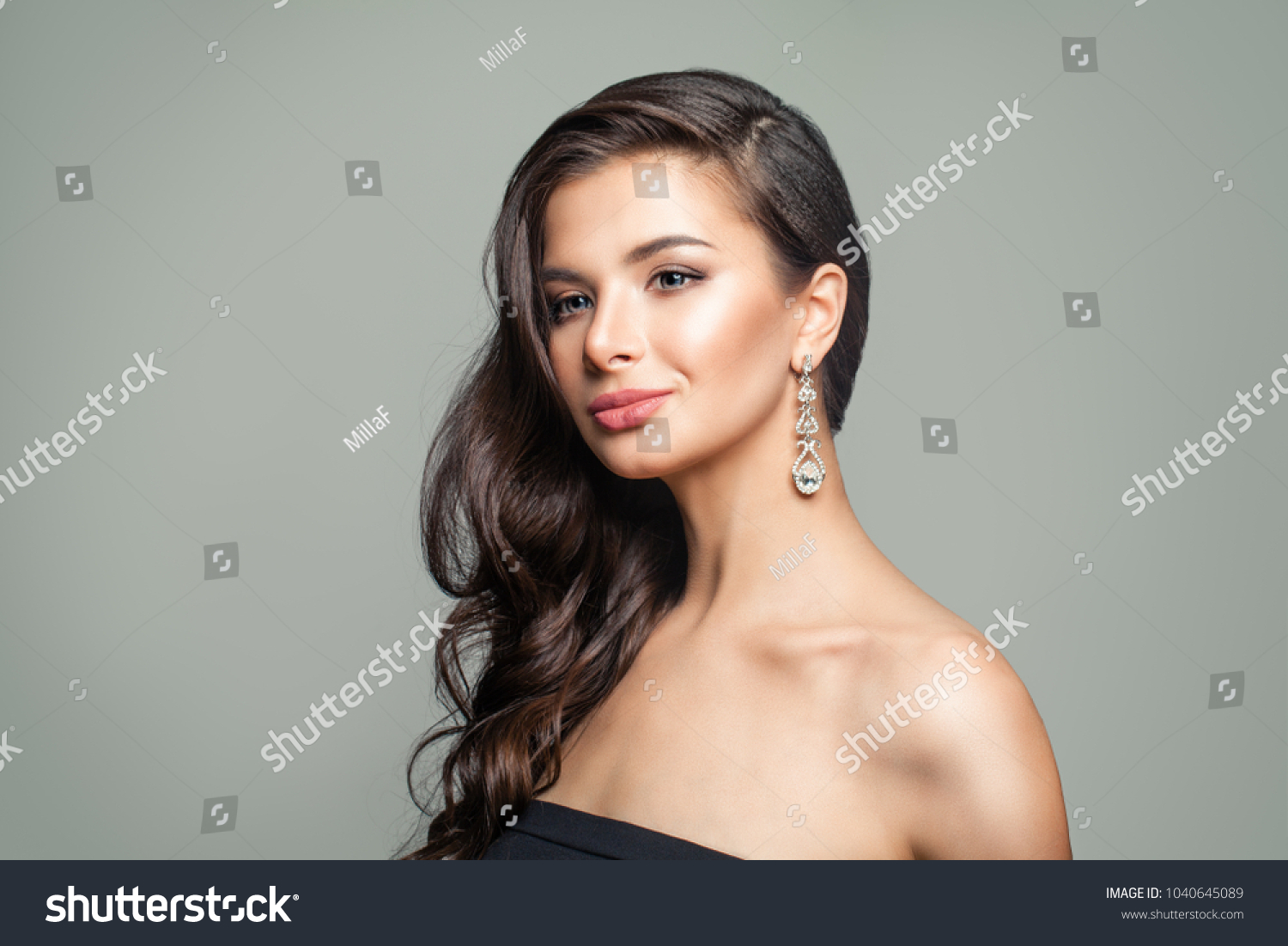 brunette dangle woman photo adult wearing image of stock to side earrings looking
