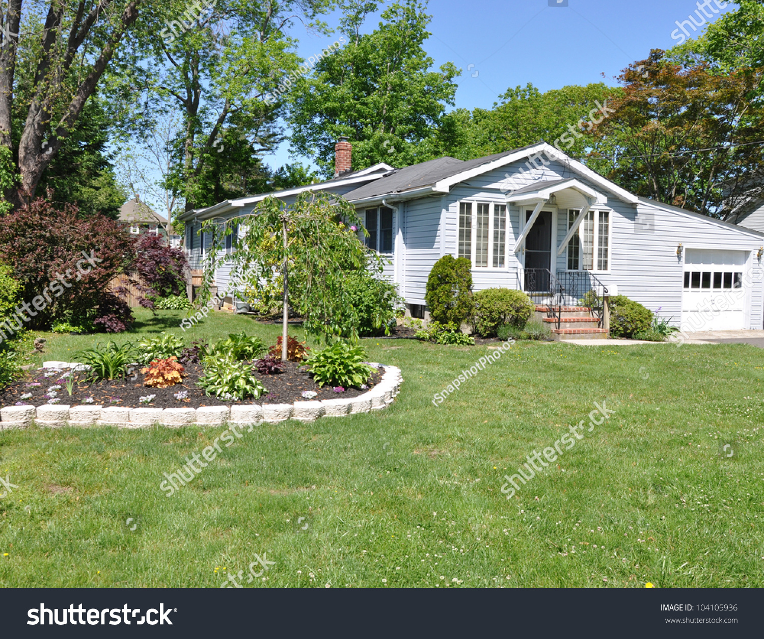 Beautiful Landscaped Suburban Cottage Style Home Stock