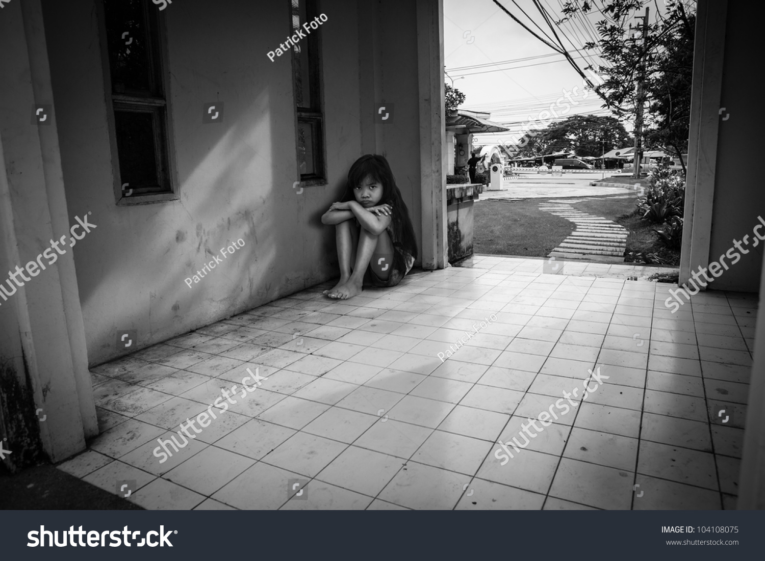 Sad little girl in black white color