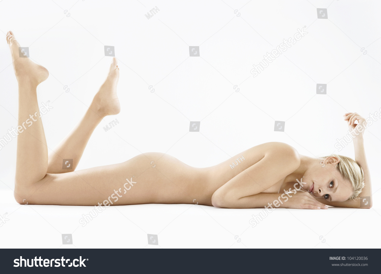 Nude women with needle through pussy