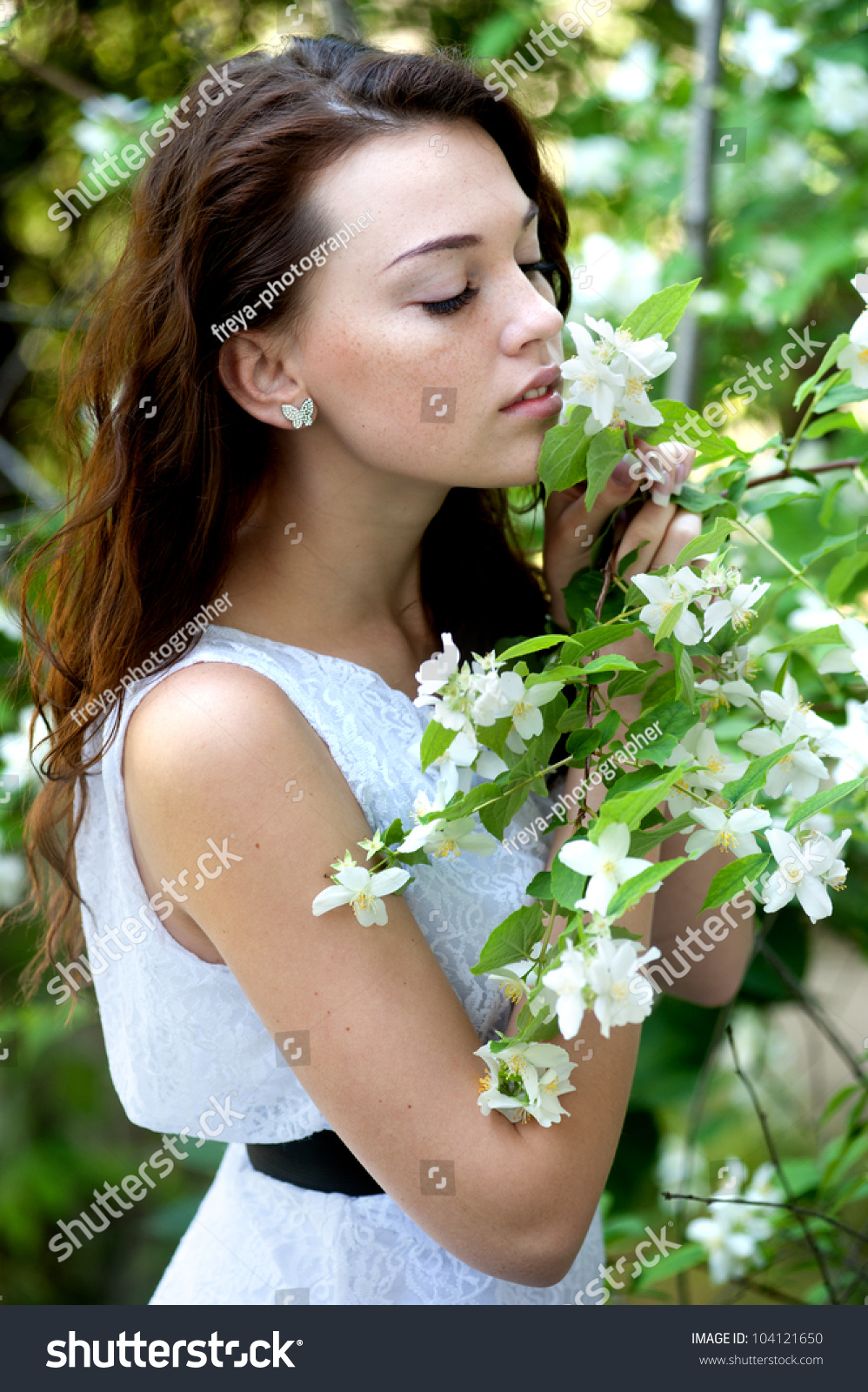 Beautiful girl sniffing jasmine flowers garden stock photo edit now beautiful girl sniffing jasmine flowers in the garden izmirmasajfo