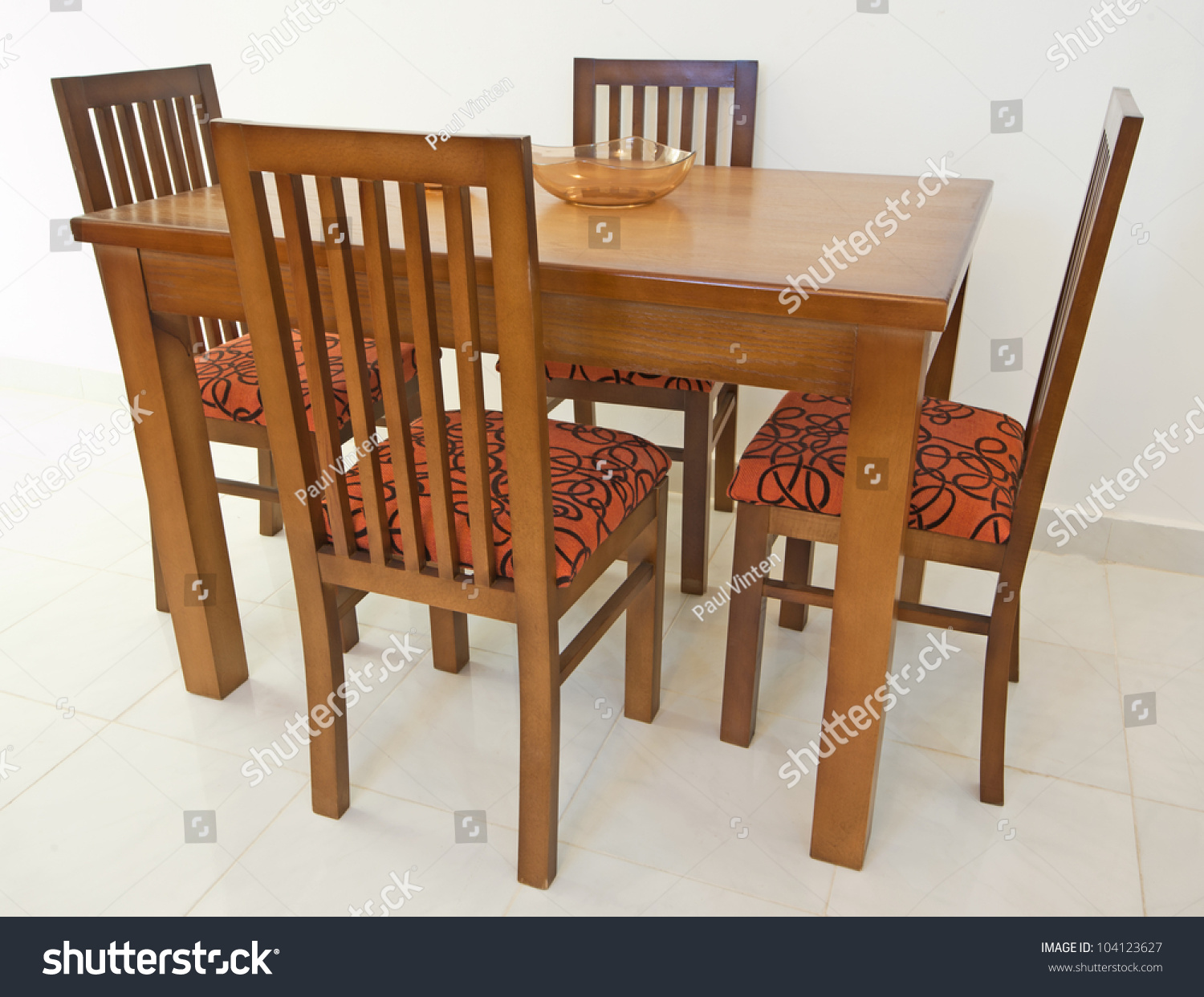 Dining Table And Four Chairs In An Apartment Against White Wall Part 94