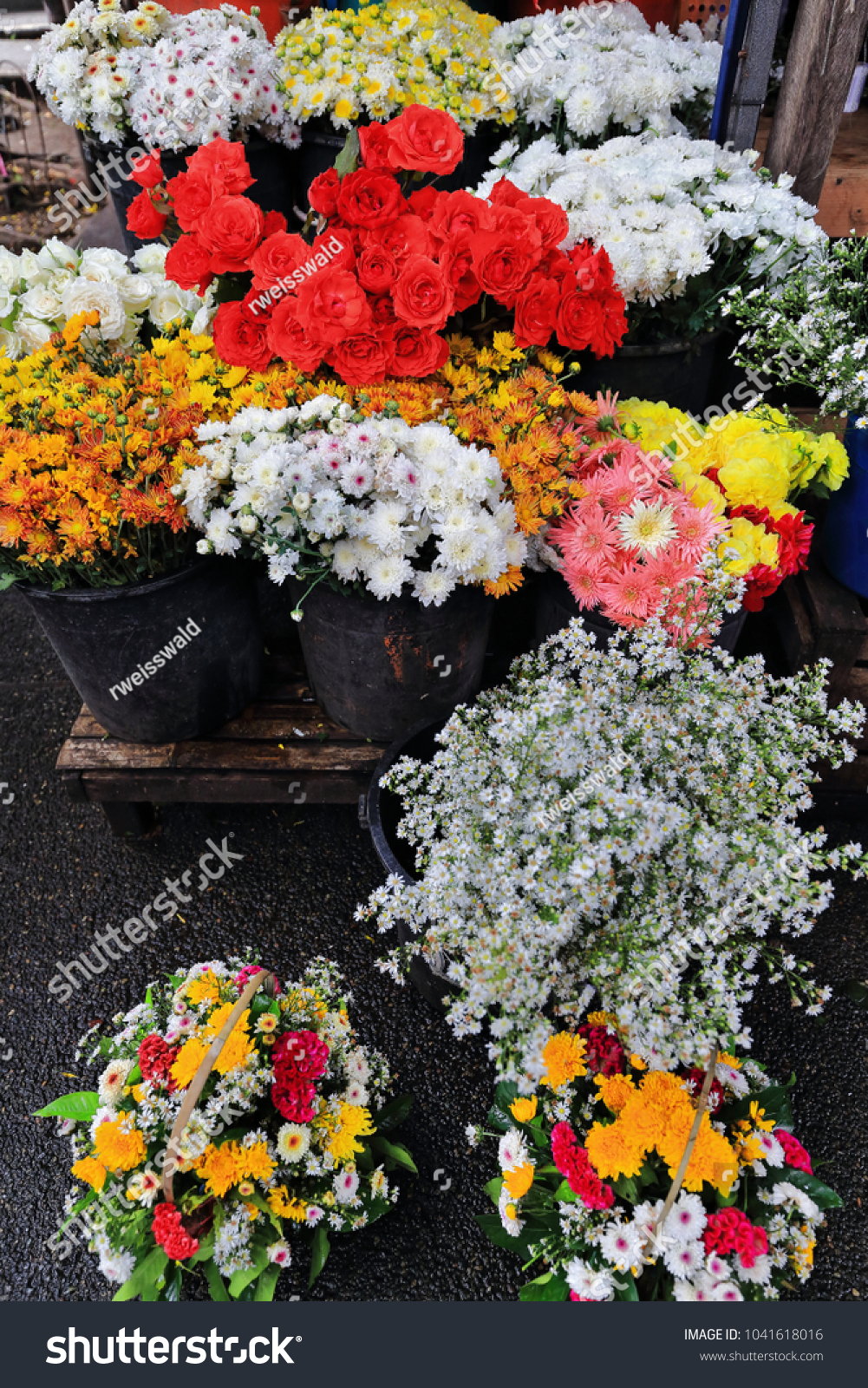 Flowers sale bouquets flowerpots flower stand stock photo edit now flowers for sale bouquets and flowerpots in a flower stand placed in the public izmirmasajfo
